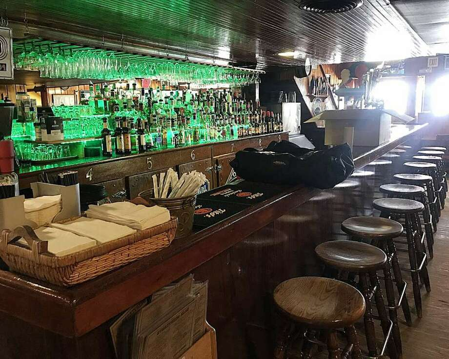 St. Patrick's Day in Big Rapids is normally a busy time for local area bars and restaurants, but at Schuberg's Bar and Grill, business was confined to take-out only due to the threat of coronavirus. Photo: Pioneer Photo/Taylor Fussman