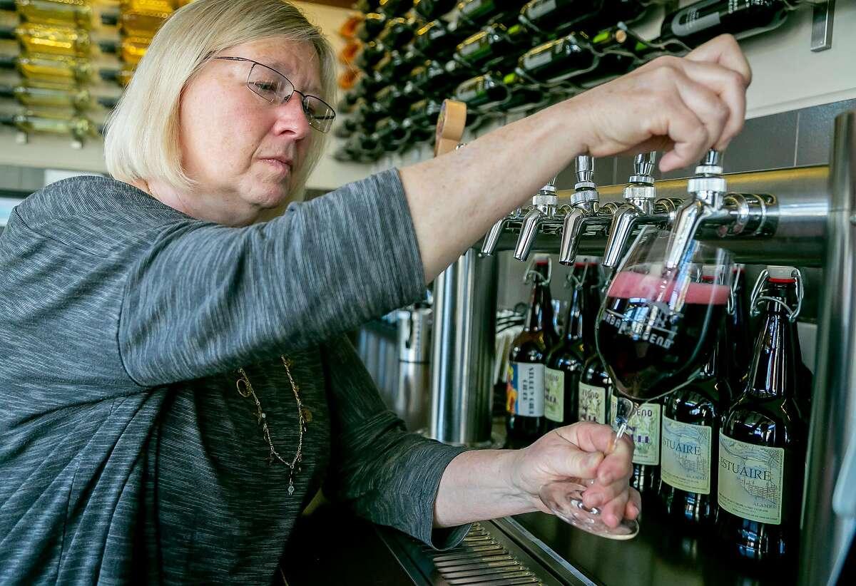 Winemaker Marilee Shaffer pours wine at the Urban Legend tasting room in Oakland, Calif. on September 7th, 2018.