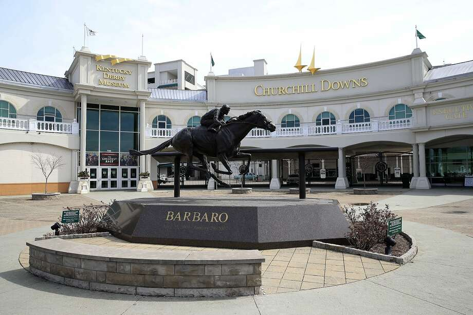 LOUISVILLE, KENTUCKY - MARCH 17: Churchill Downs sits mostly empty following the announcement that the 146th Kentucky Derby will be postponed until September 5th due to the Coronavirus on March 17, 2020 in Louisville, Kentucky. Because of the concern of (COVID-19) It is the first time since 1945 that the Kentucky Derby has not been held on the first Saturday in May. (Photo by Andy Lyons/Getty Images) Photo: Andy Lyons / Getty Images