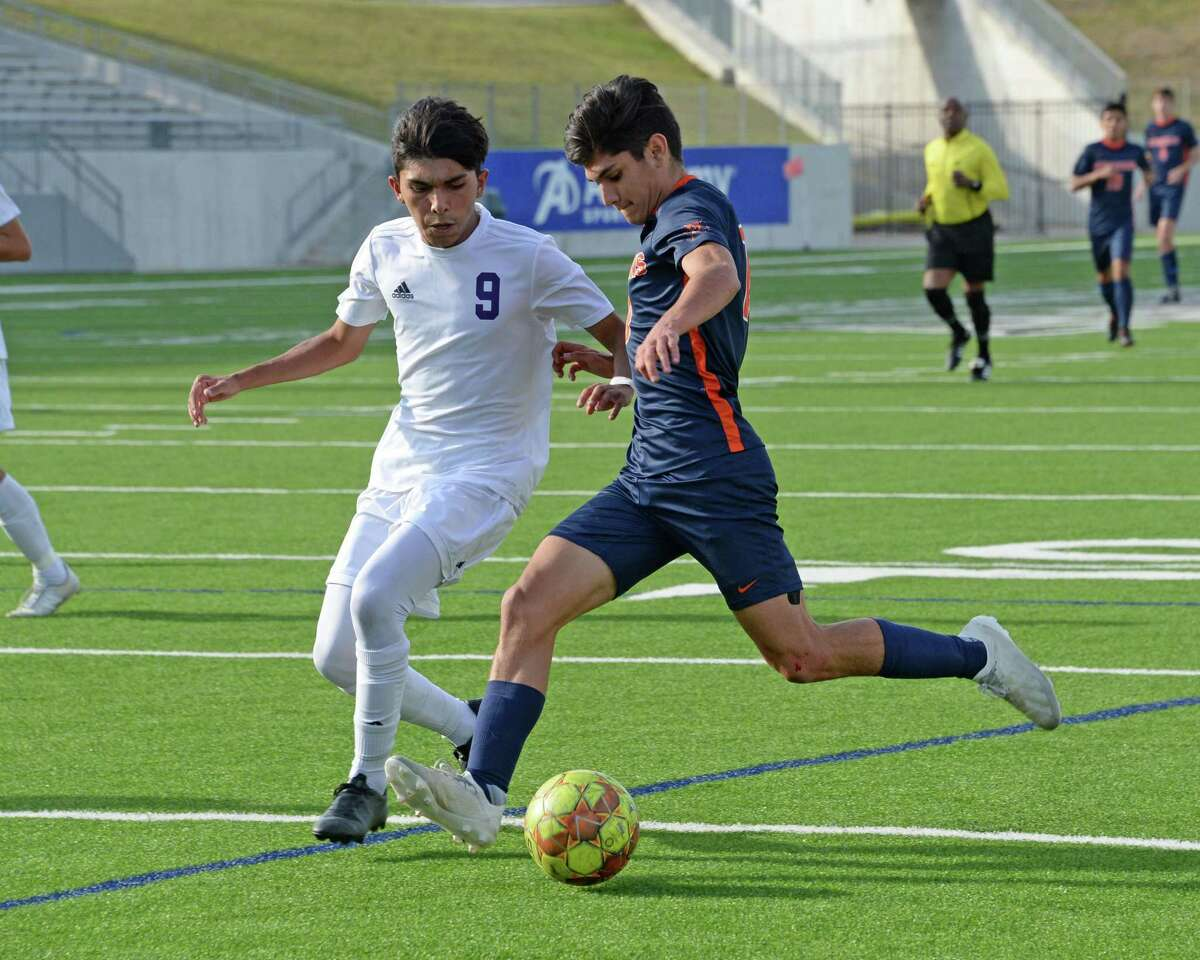 JP Dominguez (10) of Seven Lakes passes around Daniel Alaniz (9) of Jersey Village during the first half of Region III Area Round soccer playoff match between the Seven Lakes Spartans and the Jersey Village Falcons on Tuesday, April 2, 2019 at Legacy Stadium, Katy, TX.