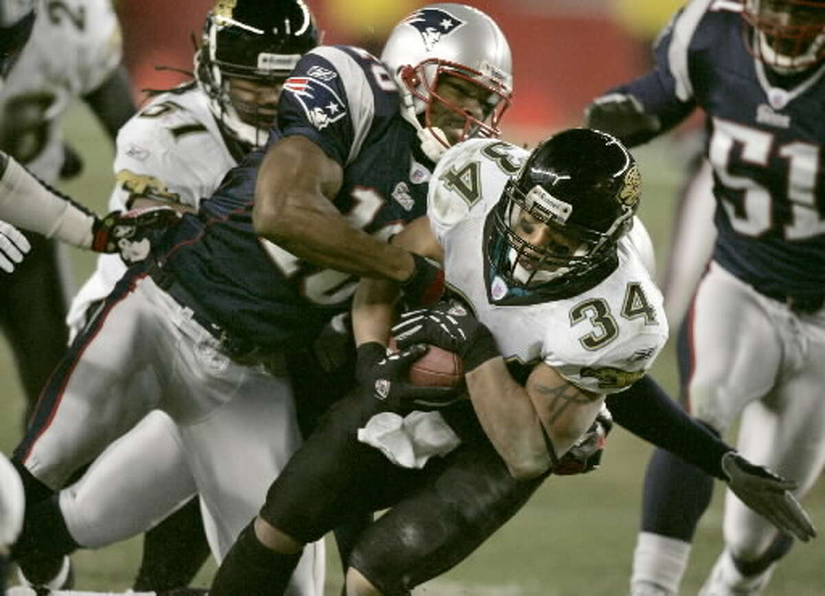 Niskayuna's Andre Davis, shown making a special-teams tackle in a playoff game against Jacksonville, caught passes from Tom Brady with the Patriots during the 2005 season. (Associated Press)