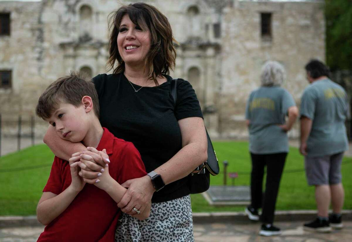 Seth Taylor, 8, leans against his mother, Shelly Taylor of Amarillo, as they make a visit to the Shrine of Texas Liberty. Alamo Plaza crowds were sparse.