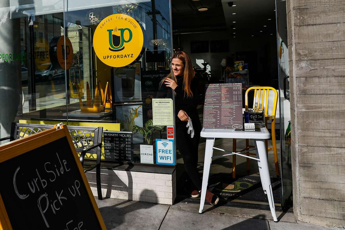 Owner Mera Shamieh at coffee shop UpForDayz Valencia Street on Tuesday, March 17, 2020 in San Francisco, California. The cafe is offering curb side coffee pick up and serving from a window stall.