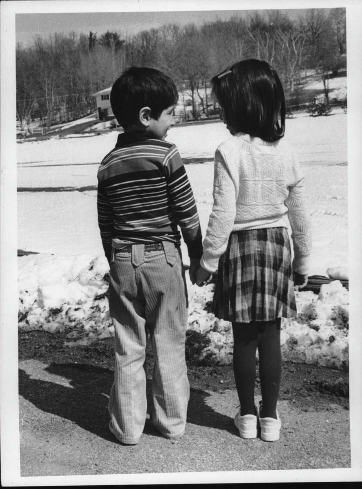 Boght Hills School - John Ambuhl (age 5) and Christine Scripss (age 5), kindergarten students feel spring in the air. March 18, 1983 (Arnold LeFevre/Times Union Archive)