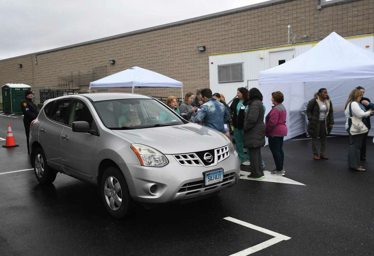 A drive through coronavirus testing station is set up behind St. Vincent's Bridgeport Health & Wellness Center at 2979 Main Street in Bridgeport, Conn. on Tuesday, March 17, 2020. Nurses practiced the procedure for taking test swabs from patients.