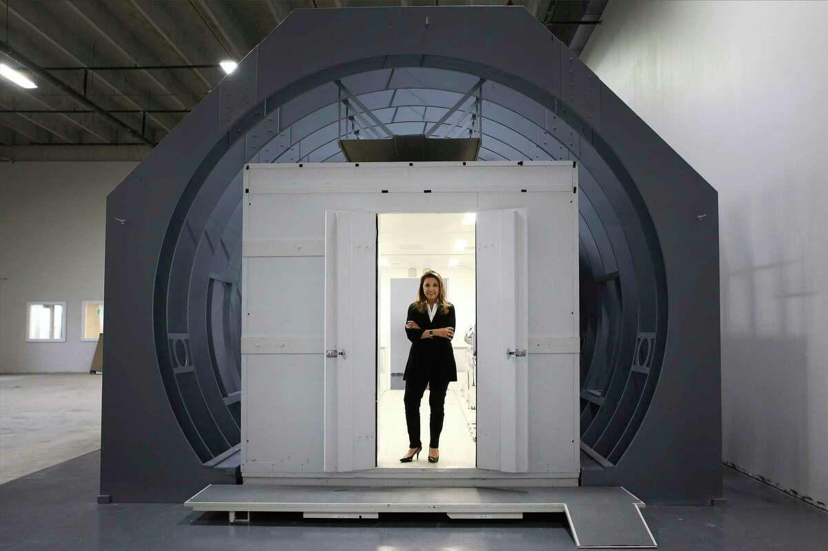 Knight Aerospace has started building flying hospital rooms to help governments respond to medical crises like COVID-19. CEO Bianca Rhodes - pictured standing inside a mockup of one their modules fitted inside the frame of an aircraft cargo bay - said their Universal Patient Modules are better designed and built to handle the rigors of flight and are customized to the needs of their clientele. Knight Aerospace, headquartered at Port San Antonio, recently moved into a larger facility to ramp up production of their modules. One of their modules - depending upon customization - takes about four to six months to complete and shipped to the buyer according to Rhodes.