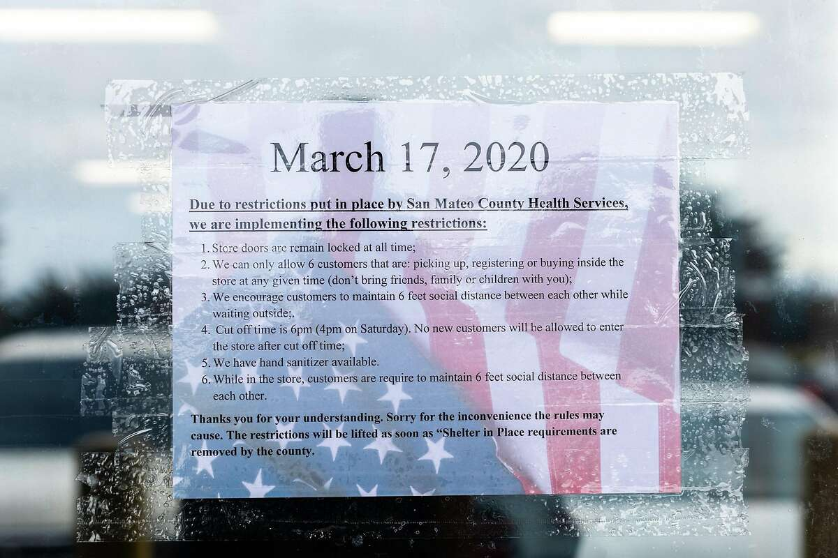 A paper sign with restrictions information put in place by San Mateo County Health Services is displayed at City Arms on Tuesday, March 17, 2020, in Pacifica, Calif.
