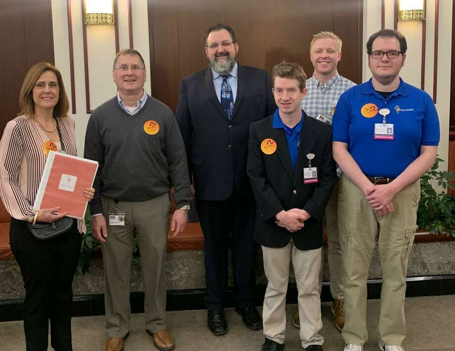 LARC's Project Search Team attended the 7th Annual Arc Connecticut/IDD Caucus Family Hearing Day, held Feb. 26 at the Capitol in Hartford. From left are Project Search team member, Kathy Riberdy, coordinator and special educator; Michael Menard, LARC Executive Director; DDS Commissioner, Jordan Scheff; Owen Reidy, Project Search intern; Ian Riddell, Project Search skills trainer, and Stephen Smith, Project Search intern. Photo: Contributed Photo /