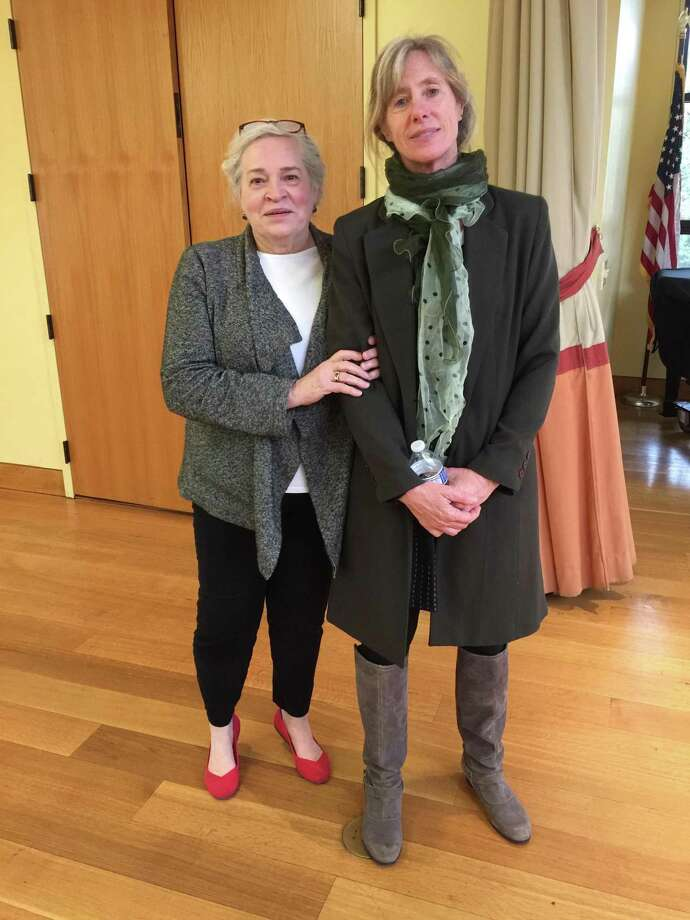The Litchfield Garden Club sponsored an Open Conservation Meeting March 12 at the Litchfield Community Center. The speaker was Megan Parker, co-founder and Director of Research for Working Dogs for Conservation. Pictured is garden club conservation chairwoman Grace Yagtug, left, with Megan Parker. Photo: Litchfield Garden Club / Contributed Photo /
