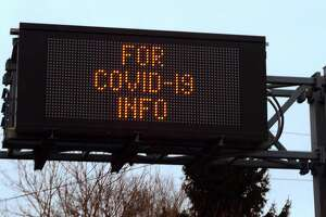 A highway sign notifies drivers to dial 211 for information on the coronavirus in Branford, Conn., on Tuesday Mar. 17, 2020.