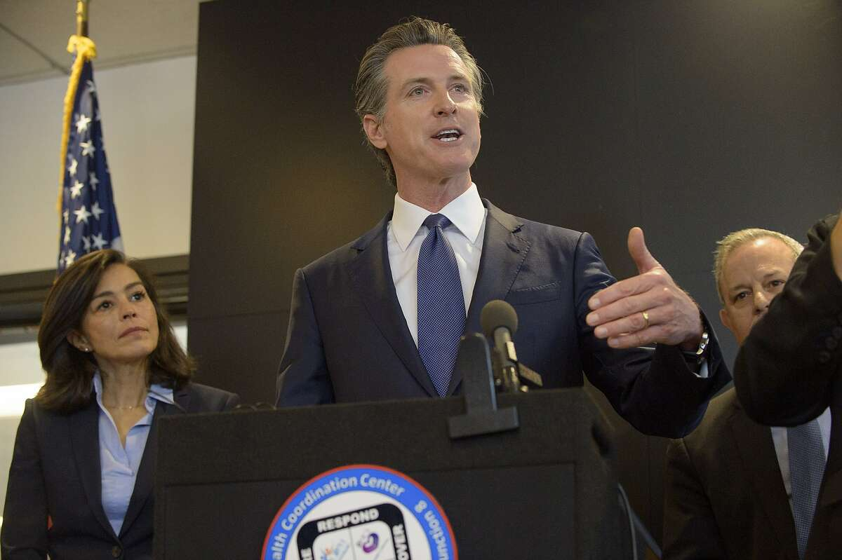 California Governor Gavin Newsom speaks to members of the press at a news conference in Sacramento, Calif., Thursday, Feb. 27, 2020.