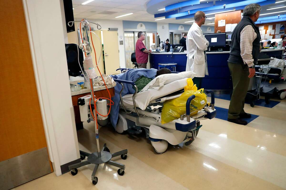 Patient waits on a bed in emergency room at San Francisco General Hospital in San Francisco, Calif., on Thursday, January 23, 2020.