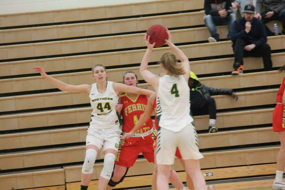 Lilly George (center) looks to make a play against Northern Michigan during the season. (Pioneer photo/John Raffel)