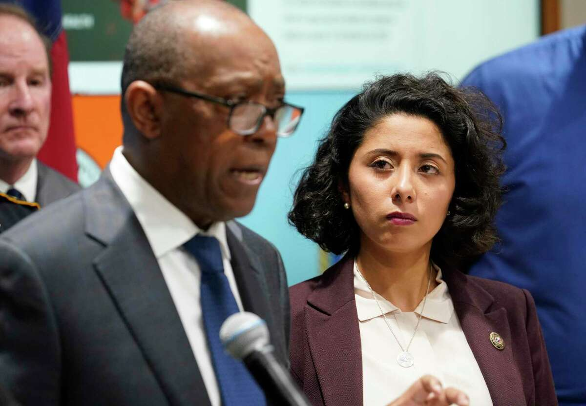 Houston Mayor Sylvester Turner, left, and Harris County Judge Lina Hidalgo, right, with others hold a COVID-19 news conference at Houston TranStar, 6922 Katy Road, Monday, March 16, 2020, in Houston. They announced that starting tomorrow for 15 days, restaurants with be takeout-only and all bars will be closed.