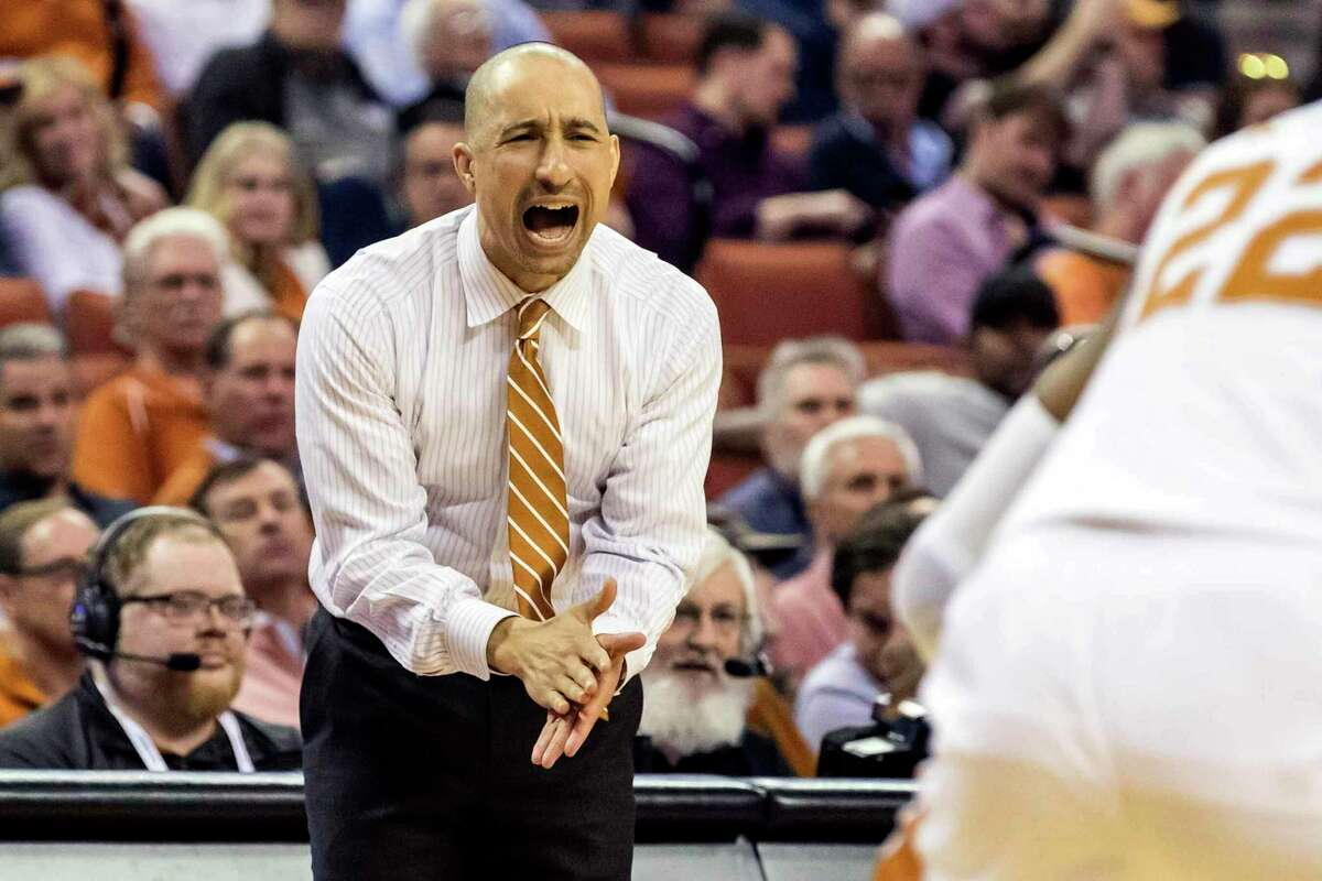 Texas head coach Shaka Smart gives instructions to his team during an NCAA college basketball game against West Virginia in Austin, Texas, Monday, Feb. 24, 2020. (Lola Gomez/Austin American-Statesman via AP)