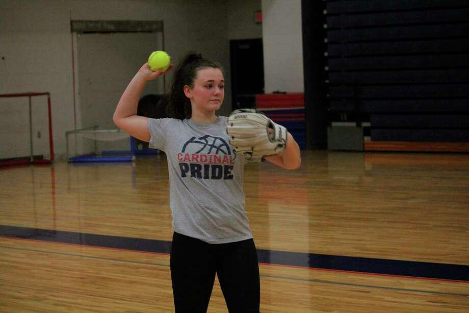 Josie Prince warms up her arm during a Big Rapids softball practice. (Pioneer photo/John Raffel)