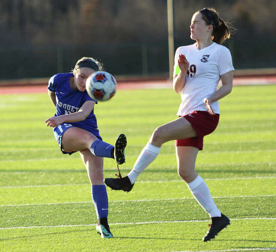 Marquette Catholic's Emma Anselm, left, in action last season against Belleville West. Anselm scored 12 goals and added six assists in 2019 for the Explorers.