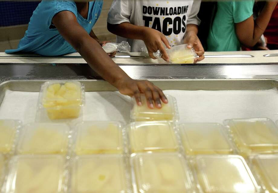Children line up for lunch at Martin Elementary School in Beaumont, which is among several locations serving up free breakfast and lunch for children up to 18 years old in the community. Several hundred children come each day to Martin, which will be providing meals to children in need through June 27th. West Brook High School will continue its free summer meals through August 2nd. The program is sponsored by the Texas Department of Agriculture, and no registration or proof of residency is required. For more information on times and locations, call (877) TEX-MEAL or search online at http://squaremeals.org/Programs/SummerFeedingPrograms/SummerFeedingInteractiveMap.aspx Photo taken Monday, June 10, 2019 Kim Brent/The Enterprise Photo: Kim Brent / The Enterprise / BEN