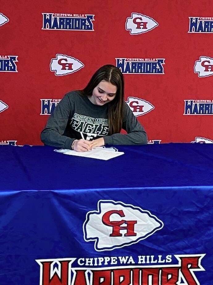 Chippewa Hills' Emily Gandy signs her letter to Eastern Michigan. (Courtesy photo)