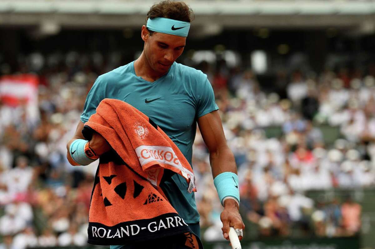 Spain's Rafael Nadal walks on court between points against Austria's Dominic Thiem during their men's singles final match on day fifteen of The Roland Garros 2018 French Open tennis tournament in Paris on June 10, 2018. / AFP PHOTO / CHRISTOPHE SIMONCHRISTOPHE SIMON/AFP/Getty Images