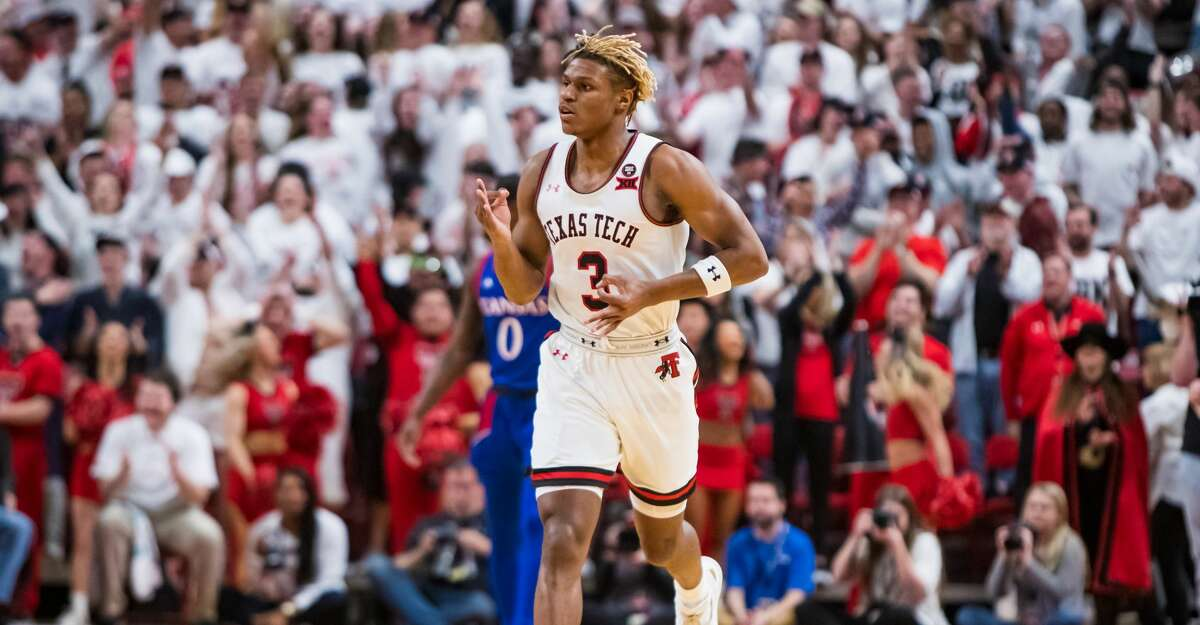 Guard Jahmi'us Ramsey #3 of the Texas Tech Red Raiders gestures after making a three-pointer during the first half of the college basketball game against the Kansas Jayhawks on March 07, 2020 at United Supermarkets Arena in Lubbock, Texas. (Photo by John E. Moore III/Getty Images)
