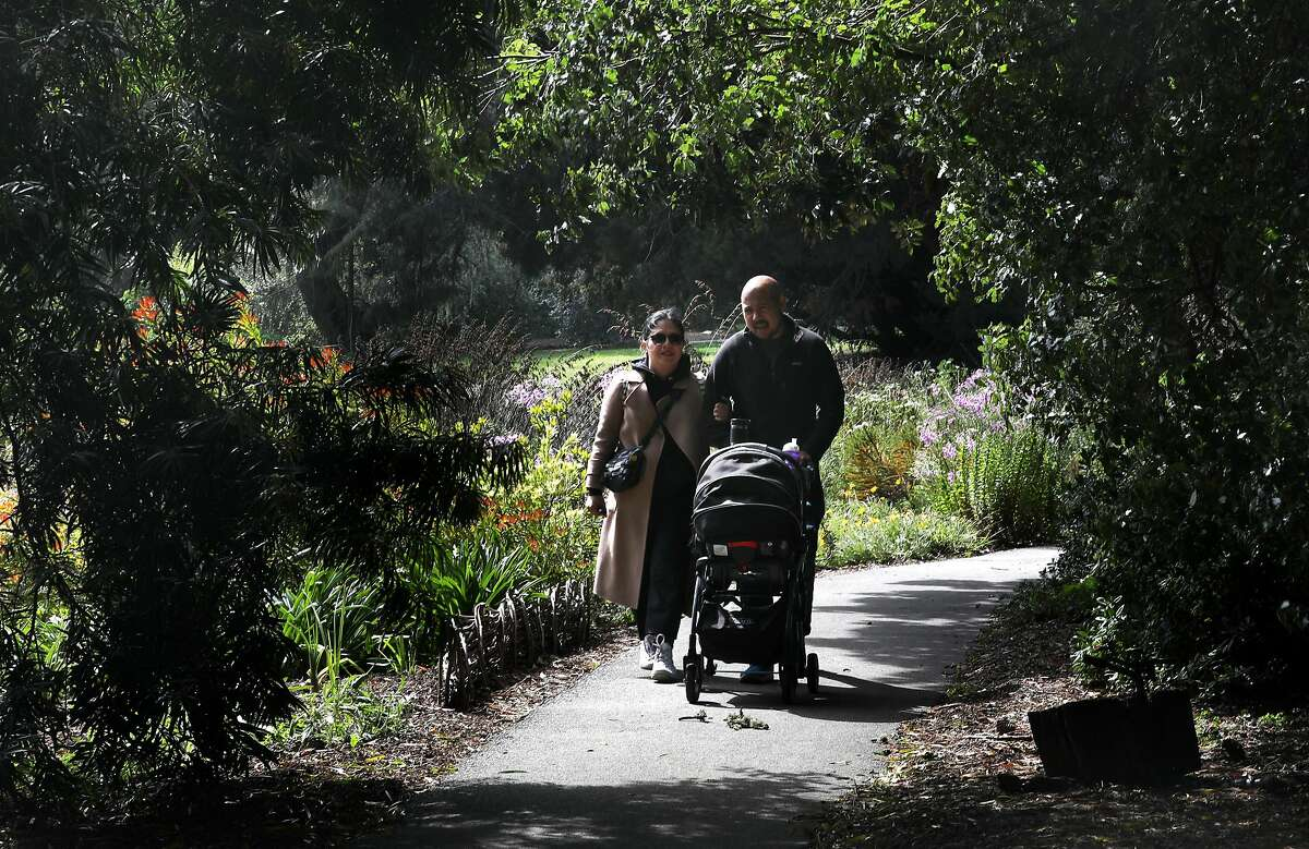 Brenda Intengan and Danilo Seze from San Francisco walk their one year old son Orion Seze at SF Botanical Gardens on Friday, March 13, 2020, in San Francisco, Calif. Brenda mentions she walks here almost every week this year and always finds a new path.