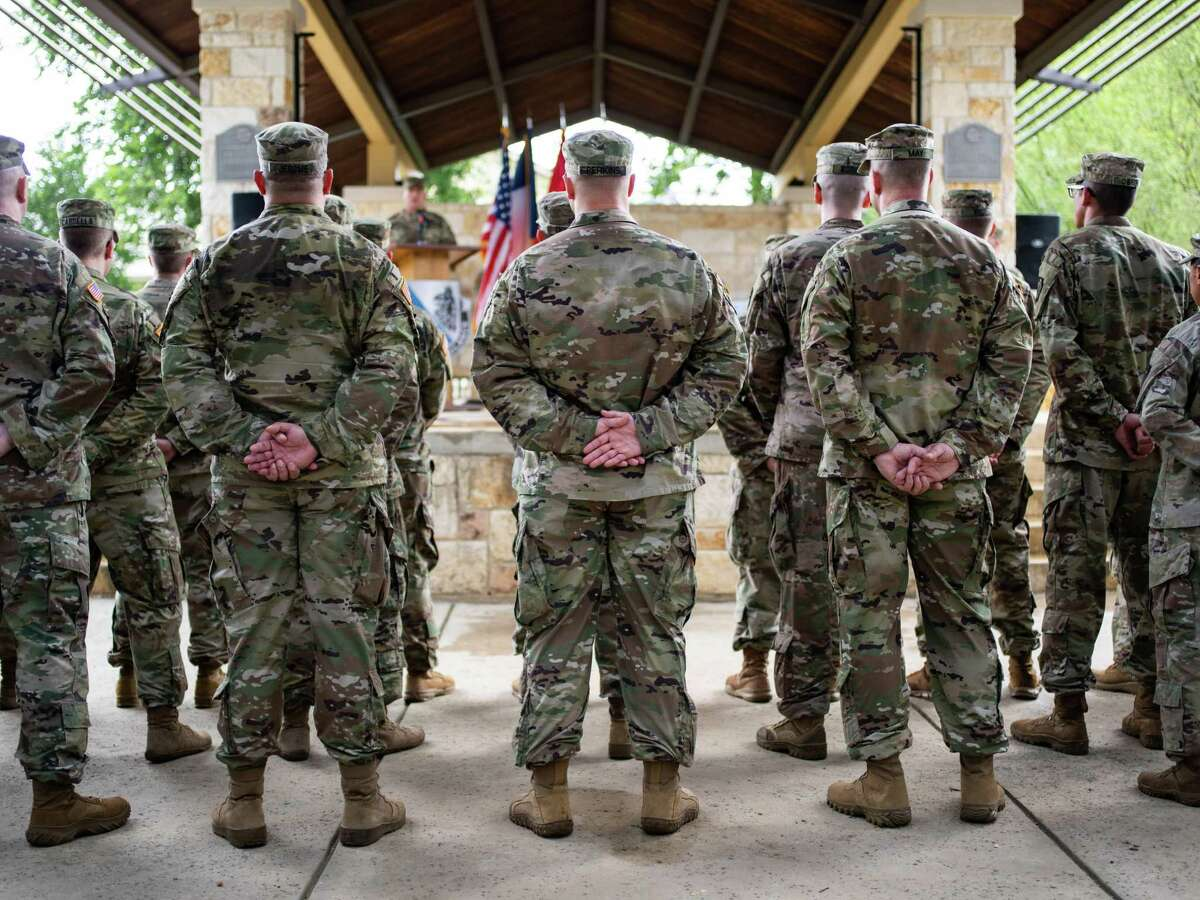 Members of the Texas Army National Guard's 636th Expeditionary Military Intelligence Battalion attend a deployment ceremony attended by top officials and family members at San Antonio Military Medical Center on Saturday, May 25, 2019. Gov. Greg Abbott is activating the Texas Army National Guard to help in the battle against COVID-19.