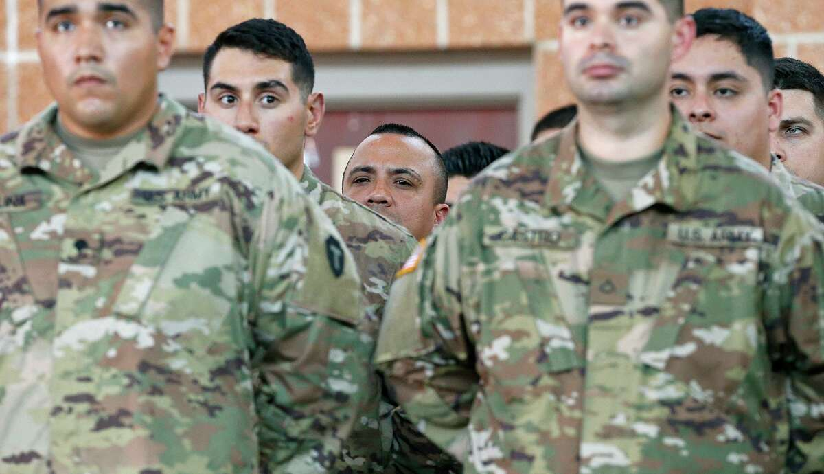 Members of the Texas Army National Guard listen to Texas Gov. Greg Abbott speak at the Sergeant Tomas Garces Texas Army National Guard Armory Thursday April 12, 2018 in Weslaco, Tx.