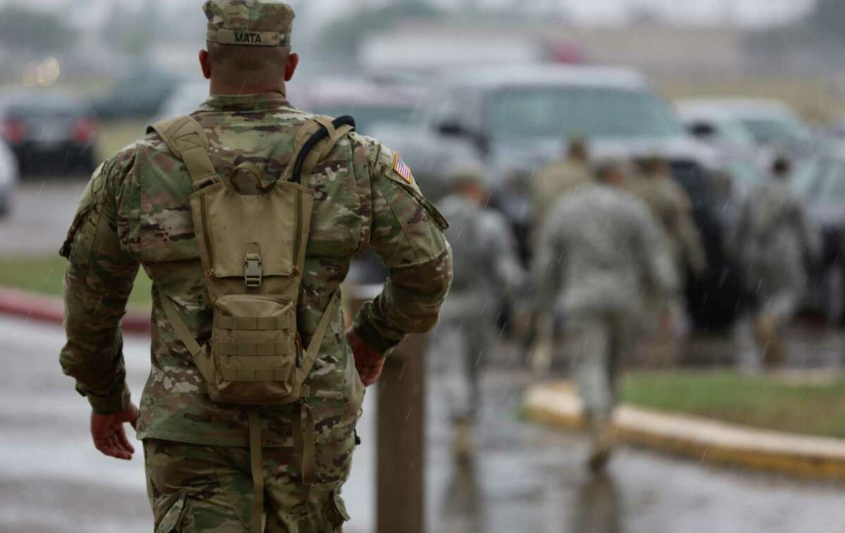 Members of the Texas National Guard gather at the Armory in Weslaco before heading out to a post along the Rio Grande River on Tuesday, April 10, 2018.