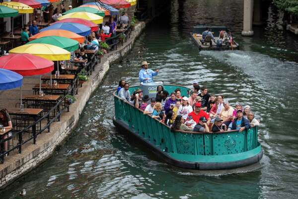 A Go Rio barge with at least 34 people glides along the River Walk in downtown San Antonio on Monday, March 16, 2020. The size of the tour group caught the attention of a few onlookers, given concerns about the spread of the novel coronavirus.