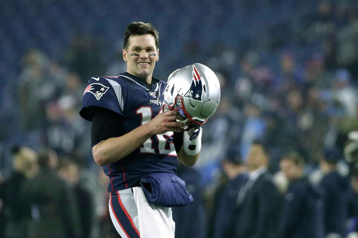 FILE - In this Jan. 4, 2020, file photo, New England Patriots quarterback Tom Brady warms up before an NFL wild-card playoff football game against the Tennessee Titans in Foxborough, Mass. Tom Brady is an NFL free agent for the first time in his career. The 42-year-old quarterback with six Super Bowl rings said Tuesday morning, March 17, 2020, that he is leaving the New England Patriots. (AP Photo/Elise Amendola, FIle)