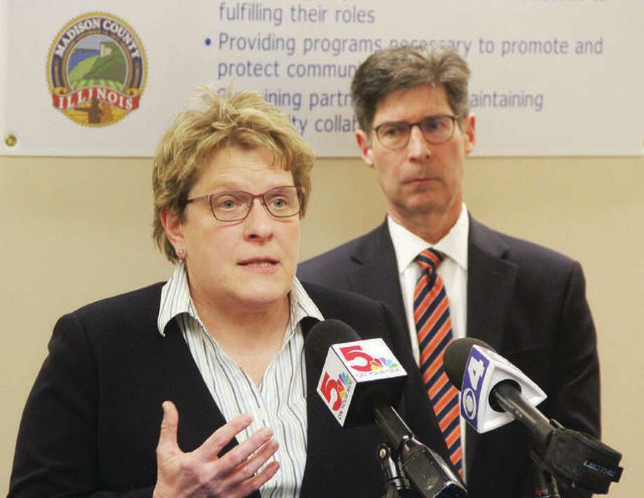 """Madison County Health Department Administrator Toni Corona and County Board Chairman Kurt Prenzler speak Tuesday night at a press conference announcing Madison County's first case of COVID-19. The patient, identified as a male in his 30s, had returned from travel to a """"high-risk"""" area of Europe, and is in isolation at his home. Photo: Scott Cousins