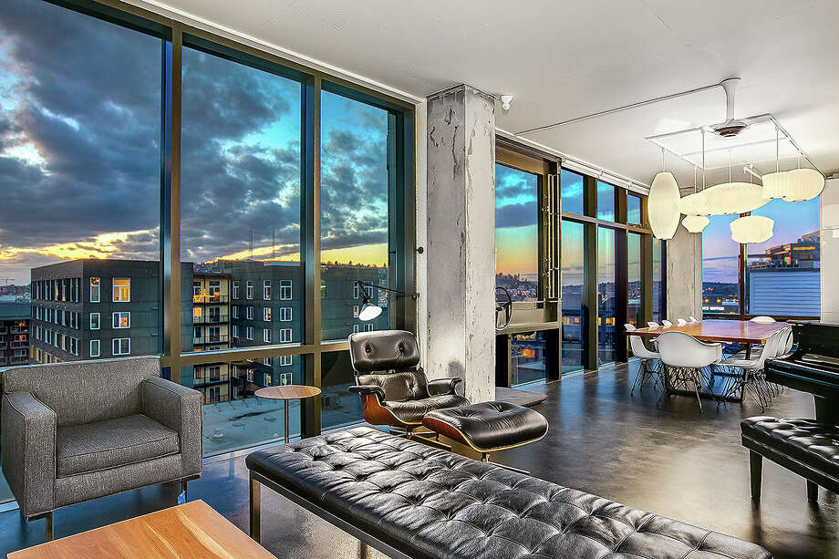In an Olson Kundig designed building, once a horse stable, this modern art of a condo could be yours for $3M Photo: Greg@GregWhitePhoto.com, Current Listing Photos: Seattle Home Photography.; Before Shot Courtesy Dick Hardt / GWP