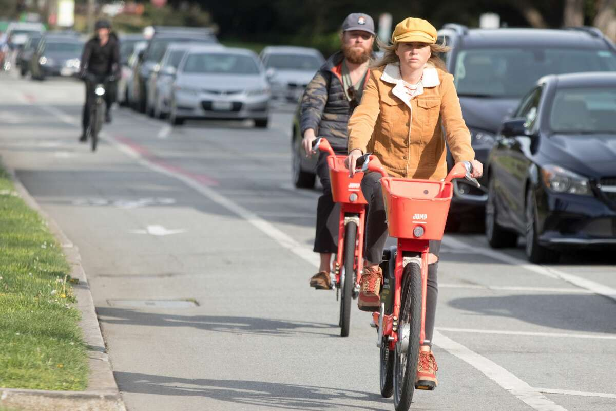 Bicyclists ride along a bike path in Golden Gate Park. San Francisco had its first shelter-in-place day on March 17th, 2020 in response to the spread of the COVID-19 coronavirus.