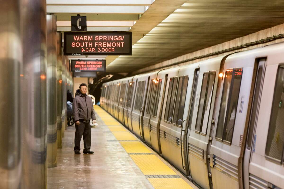 A passenger waits for a BART train during the evening commute in San Francisco in this file photo.