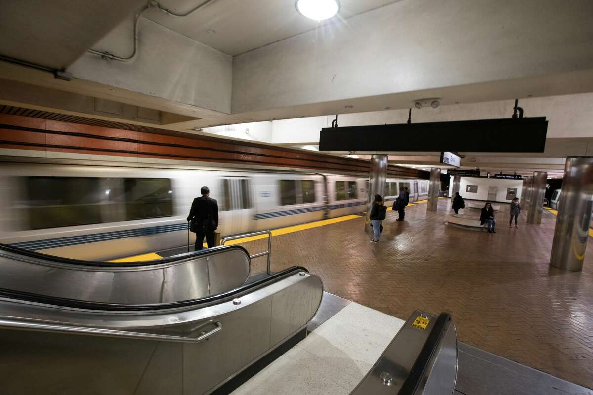 Passengers wait to board a BART train during the evening rush hour. San Francisco had its first shelter-in-place day on March 17th, 2020 in response to the spread of the COVID-19 coronavirus.