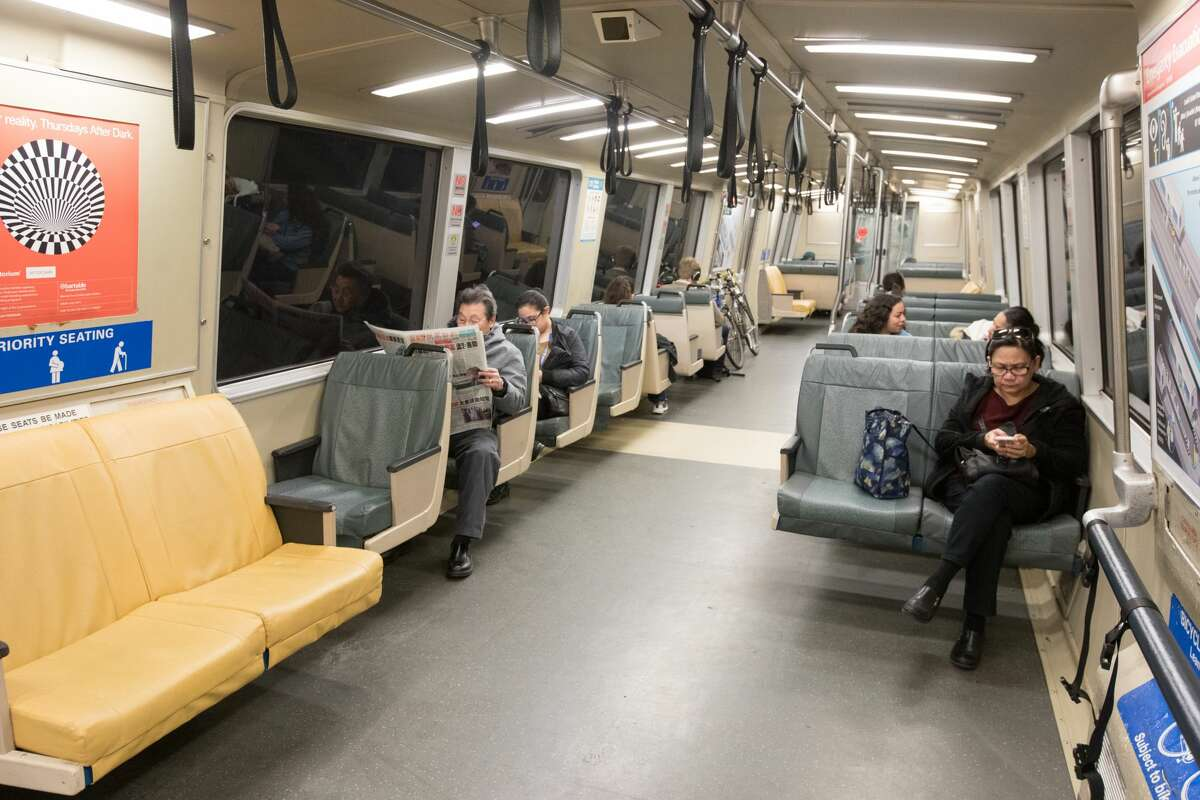 Passengers enjoy space on a normally crowded rush hour BART train.