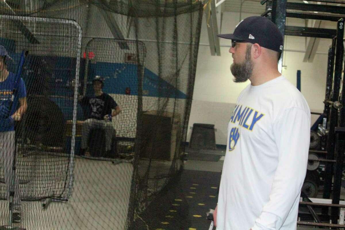 Evart baseball coach Josh Johnson watches his team during a practice on Friday night inside the Wildcat gymnasium. (Herald Review photo/John Raffel)