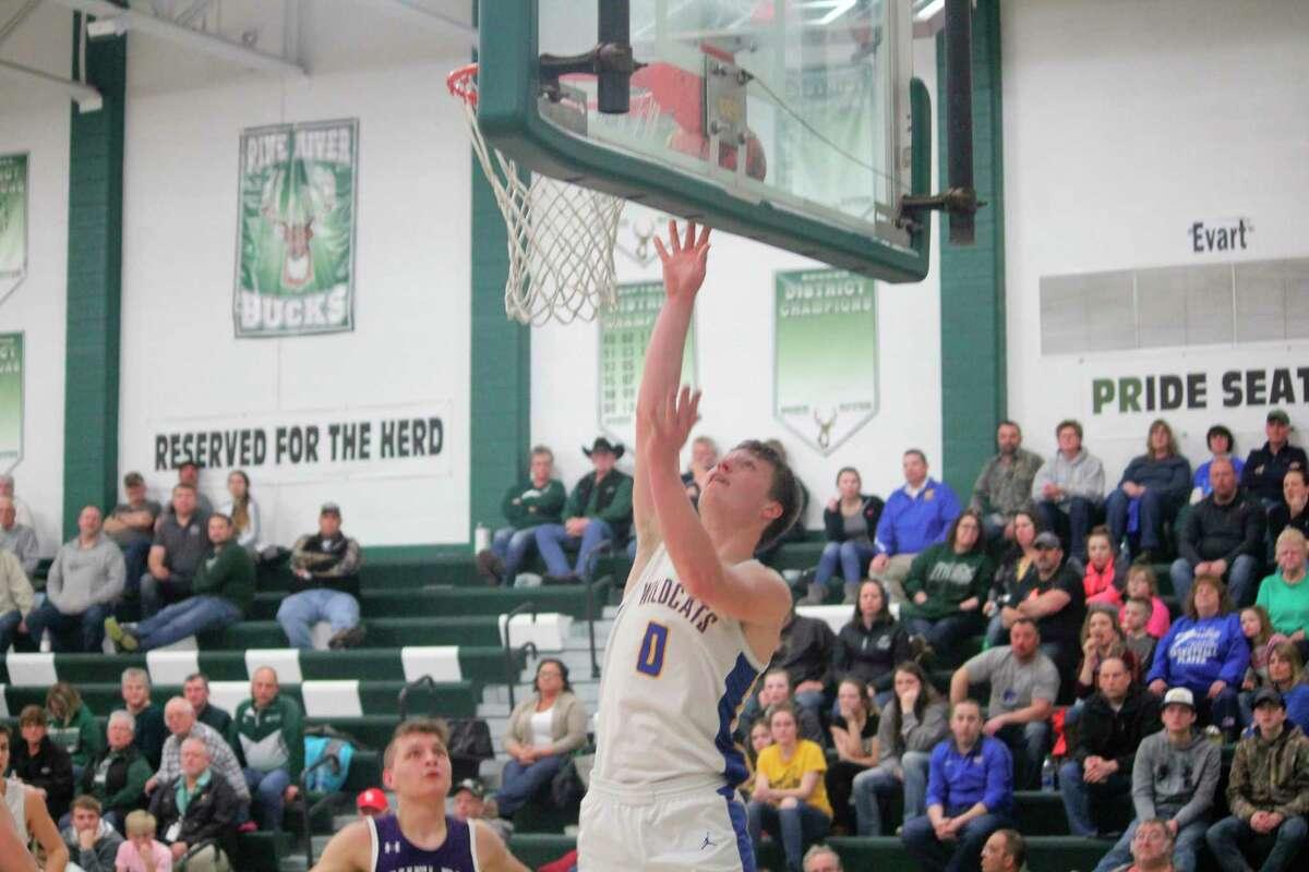 Evart's Donavin Reagan goes up for the basket against Shelby. (Herald Review photo/John Raffel)
