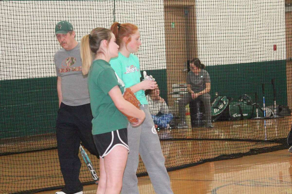 Pine River softball coach Mike Nelson (left) watches his team go through a practice session on Friday. (Herald Review photo/John Raffel)