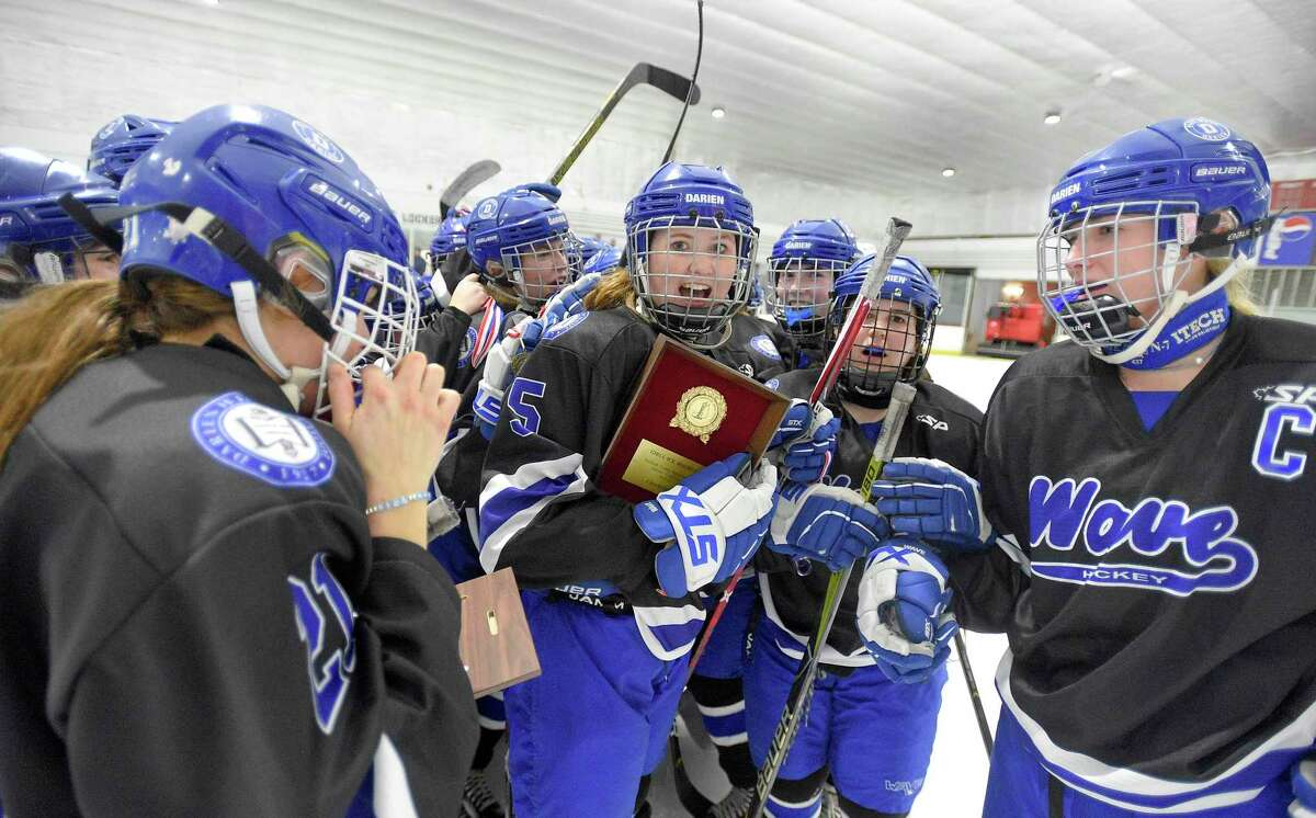 Darien captain Cate Droogan celebrates with her teammates after defeating New Canaan 4-2 in the FCIAC Girls' Ice Hockey finals at the Darien Ice House in Darien, Conn., Saturday, Feb. 29, 2020.