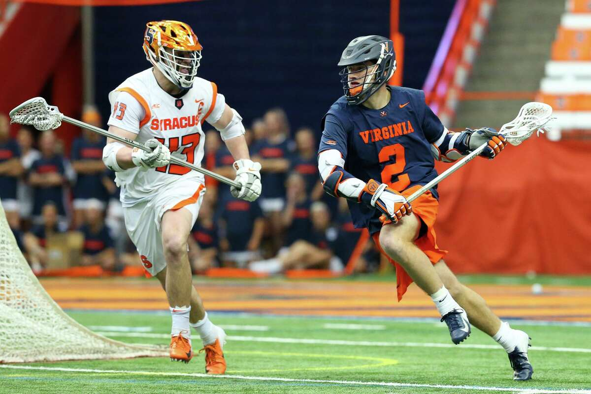 SYRACUSE, NY - MARCH 02: Michael Kraus #2 of the Virginia Cavaliers dodges to the goal against the defense of Marcus Cunningham #43 of the Syracuse Orange during the second half at the Carrier Dome on March 2, 2019 in Syracuse, New York. Virginia defeated Syracuse 15-14 in overtime. (Photo by Rich Barnes/Getty Images)