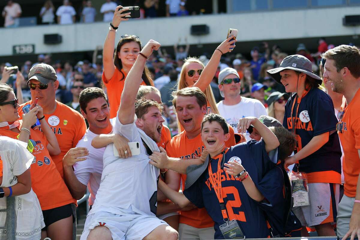 PHILADELPHIA, PA - MAY 27: Michael Kraus #2 of Virginia Cavaliers celebrates with the fans after beating the Yale Bulldogs 13-9 for the NCAA Division I Men's Lacrosse Championship at Lincoln Financial Field on May 27, 2019 in Philadelphia, Pennsylvania. (Photo by Drew Hallowell/Getty Images)