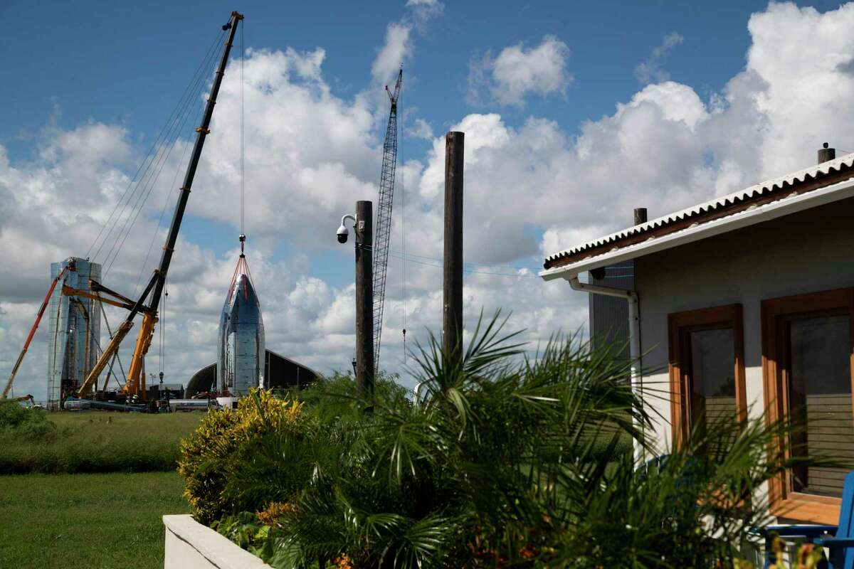 View of the SpaceX Starship vehicle prototype from the front yard of Maria Pointer on Friday, Sept. 27, 2019, in Boca Chica.