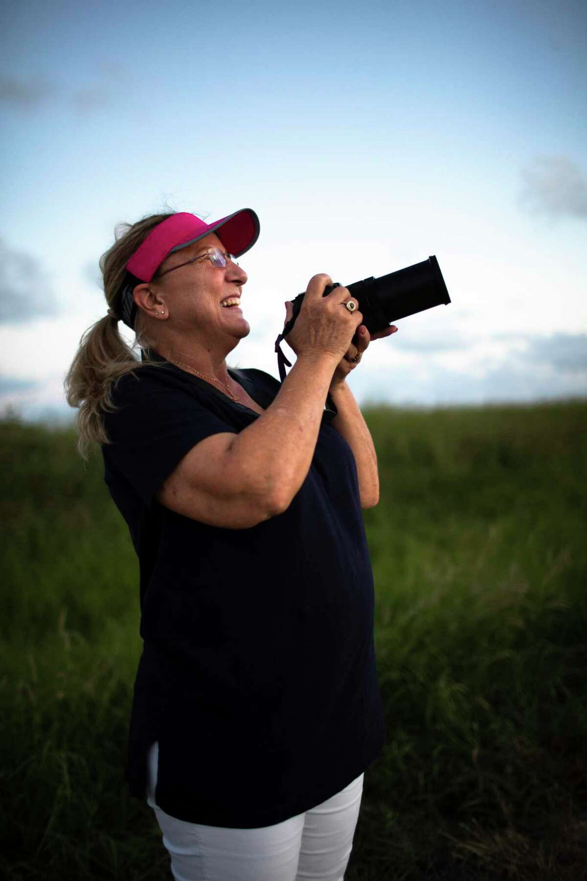 Maria Pointer, a neighbor of the SpaceX facilities in Boca Chica where a prototype of SpaceX's Starship vehicle has been constructed, photographs the vehicle at dusk on Friday, Sept. 27, 2019, in Boca Chica.