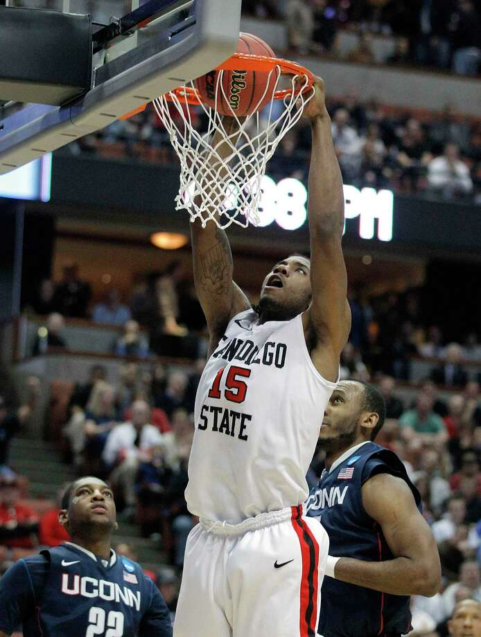 San Diego State's Kawhi Leonard dunks against Connecticut during the first half against UConn in this March 24, 2011 photo. Photo: Jae C. Hong /Associated Press File / AP2011