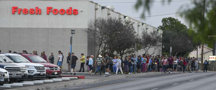 Laredoans form a line around the corner of H-E-B on Guadalupe Street, Tuesday, Mar. 17, 2020, a day after a case of COVID-19 Coronavirus was confirmed in Laredo, Tx. Photo: Danny Zaragoza/Laredo Morning Times