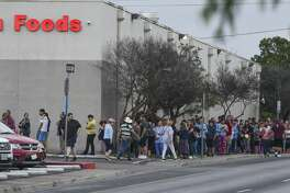 Laredoans form a line around the corner of H-E-B on Guadalupe Street, Tuesday, Mar. 17, 2020, a day after a case of COVID-19 Coronavirus was confirmed in Laredo, Tx.