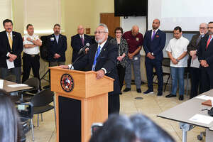 Health Department Director Hector F. Gonzalez, MD, MPH, joined by local dignitaries, speaks to the concerns regarding the COVID-19 coronavirus during a meeting, Friday, Mar. 13, 2020, at the City of Laredo Fire Department Administration Center.
