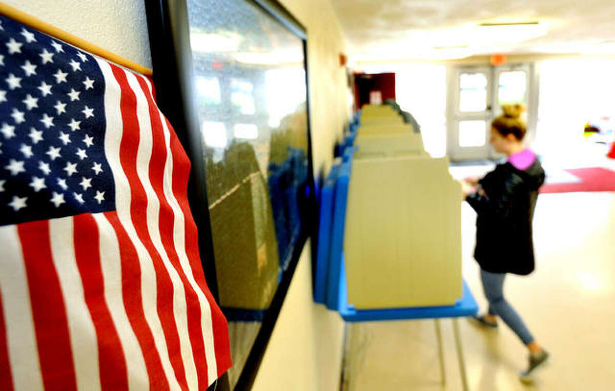 A citizen votes in the primary election at St. Mary's Catholic School in Edwardsville.